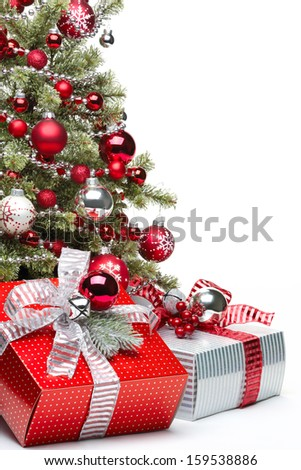 Decorated Christmas tree and gifts on white background