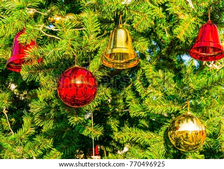 Decorated Christmas tree background, Beautiful Christmas fur-tree decorated with New Year's toys, Christmas balls decorations on pine tree #770496925