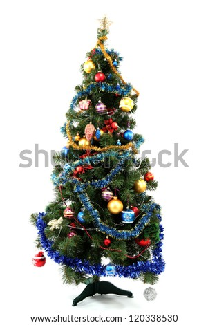 Decorated Christmas tree isolated on white - stock photo