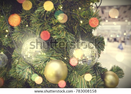 Decorated Christmas tree on blurred, sparkling background #783008158