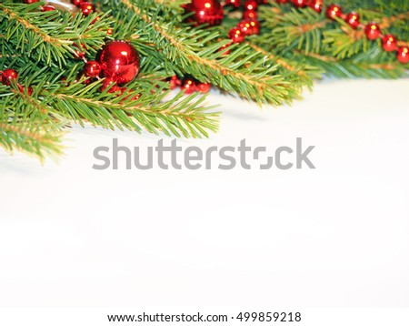 Decorated Christmas Tree on white. Red balls and beads on a spruce #499859218