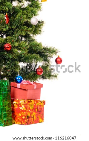 decorated christmas tree with gifts cut out from white background