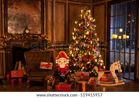 Decorated christmas tree with gifts in a room near fireplace armchair nutcracker and a pony