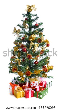 decorated Christmas tree with heap of gifts. isolated on white background