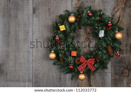 Decorated christmas wreath on barn board