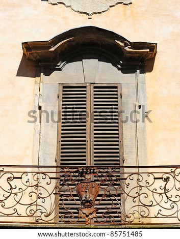 Decorated Closed Window Of Old Building In Arezzo, Italy - stock photo