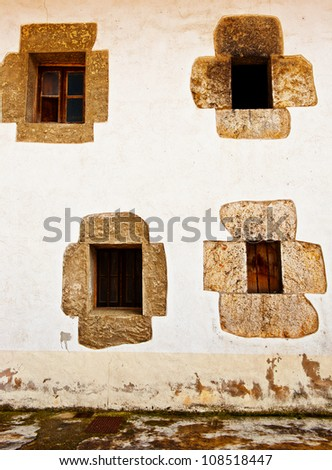 Decorated Closed Windows of Old Building in Spain