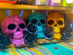 Decorated color, pottery symbol of death in the market, day of death, Mexican candles