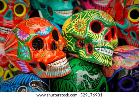 Decorated colorful skulls, ceramics death symbol at market, day of dead, Mexico #529176901