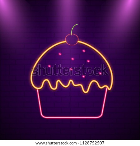 Decorated cup cake on brick wall in neon light.  - Shutterstock ID 1128752507