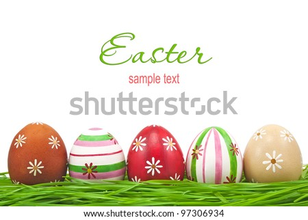 Decorated easter eggs in grass on white