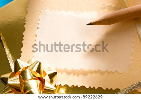 Decorated gift box on the blue background with a greeting card