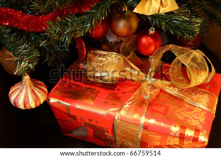 Decorated gift box  under the Christmas tree