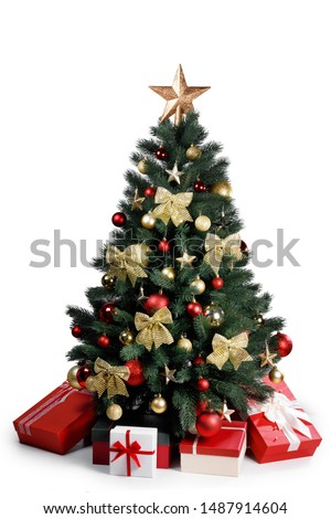 Decorated gold Christmas tree with presents for new year isolated on white background