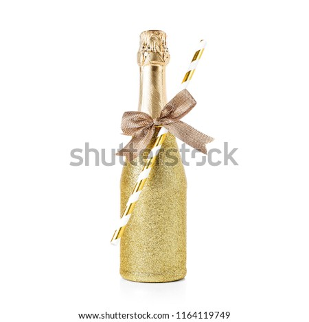 Decorated gold small bottle of champagne isolated on white background