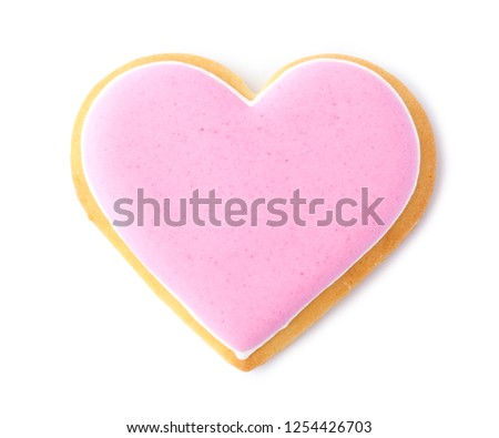 Decorated heart shaped cookie on white background, top view