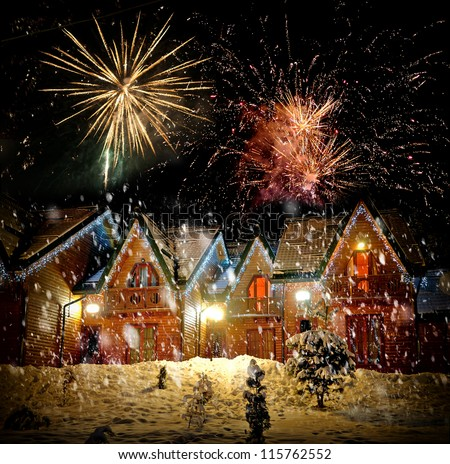 Decorated house with christmas lights and firework
