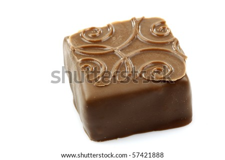 decorated luxury chocolate bonbon on a white background