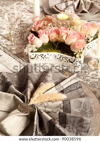 Decorated napkins and flowers on a luxury christmas dinner table