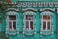 Decorated ornamental carved windows, frames on vintage wooden rural house in Suzdal town, Vladimir region, Russia. Russian traditional national folk style in wooden architecture. Countryside, village