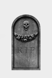 Decorated, oval granite tombstone on white background with engraved R.I.P. text, skull and carved stone flowers