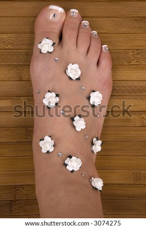 Decorated pedicured foot