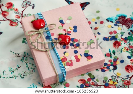 decorated present box  with a red apples and a bow