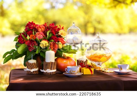 Decorated table for a romantic dinner in autumn Park. #220718635