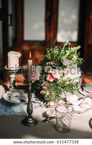 decorated table with flowers ...