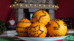 Decorated with cloves oranges for Christmas