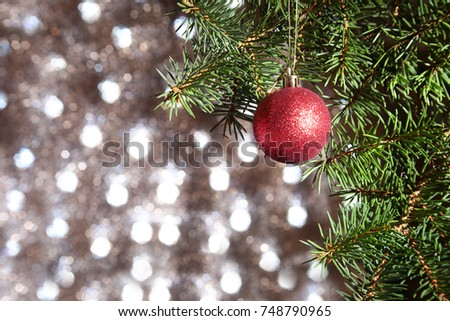 Decorated with colorful christmas balls. Christmas tree on a blurry, sparkling and fabulous background. - Shutterstock ID 748790965