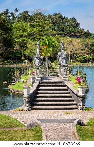 Decorated with dragons bridge in Royal water palace and pools in Tirthagangga, Bali island, Indonesia
