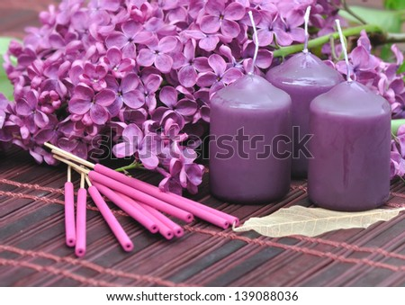 decorated with flowers of lilac purple, candles and incense  to unwind