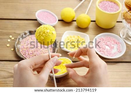 Decorating a cake pop.