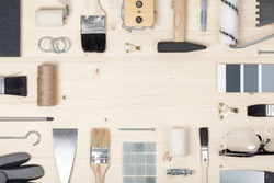 decorating and house renovation tools and accessories on wooden background. painter and decorator work table. flat lay frame composition with copy space top view