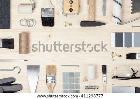 https://image.shutterstock.com/display_pic_with_logo/2337836/411298777/stock-photo-decorating-and-house-renovation-tools-and-accessories-on-wooden-background-painter-and-decorator-411298777.jpg