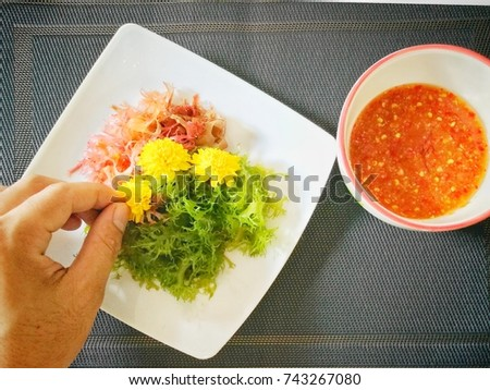 decorating the seaweed dish, seaweed dish with seafood  peste.