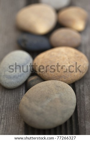 Decorating with rollers on a wooden table - stock photo