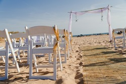 Decoration by star fish,flowers and straw,on a sand beach for wedding ceremony.