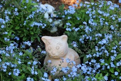 Decoration cat between blue flowers