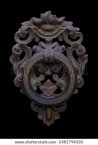 Decoration elements of buildings, vintage iron door handles, keyhole, knockers and gong handle on a black background