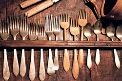 decoration for dining room, restaurant,old cutlery exposed in a piece of furniture,pieces of ethnographic museum of Galicia, alpaca forks, boxwood forks, Meixido, alpaca teaspoons,