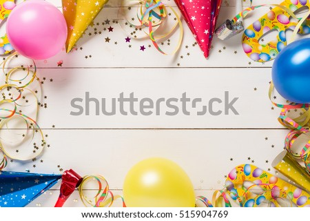 Decoration for the party. design concept. wooden white background. Top view.