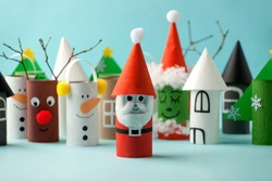 Decoration for Winter season home party - toys made with toilet paper roll. Handicraft snowman, concept of eco-friendly reuse recycle diy creative idea for Christmas and New Year