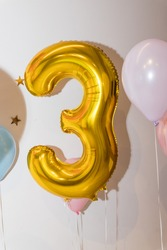 Decoration for 3 years birthday. Gold balloon.3 years celebration.third birthday or anniversary celebration.Decorative for party.