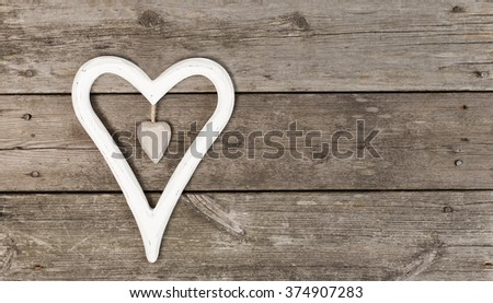 Decoration heartshaped on wooden background with copy space #374907283