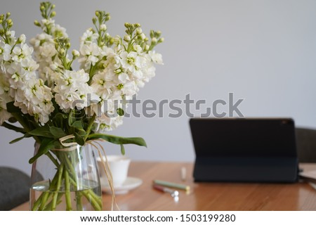 decoration in the table office with full of flowers in the vase and nobody in the room #1503199280