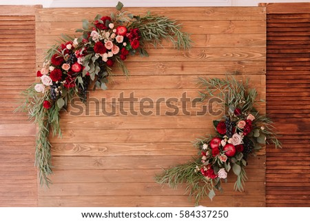 Decoration of autumnal composition of roses, apples, grape and pomergranate