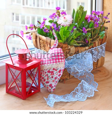 Decoration of balcony hyacinths bellis and primrose Spring flowers on a balcony
