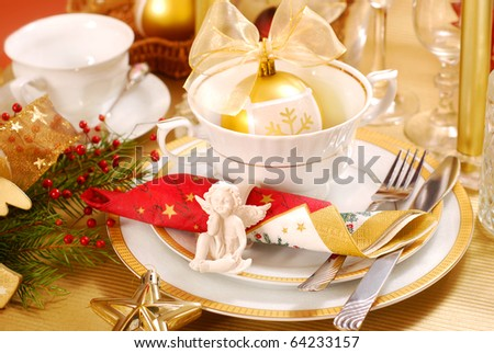 decoration of christmas table with angel in  white and golden colors